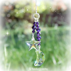 "This purple moon and star Swarovski crystal decoration is uniquely crafted for the rearview mirror or a window at home, the office, nursery or wherever you choose! The Swarovski crystal moon and star have varying lengths which gives them an elegant look. They measure approximately 20mm and are embellished with purple Swarovski crystals, purple faceted crystal beads and is wire wrapped for strength and longevity. The purple moon and star decoration is approximately 3.5"" before the chain is added and comes on your choice of the following hanging options: 1) Rearview Mirror - a silver chain with clasp 2) Window Crystal/Home Decor - a 6"" silver chain with ring for simple hanging"